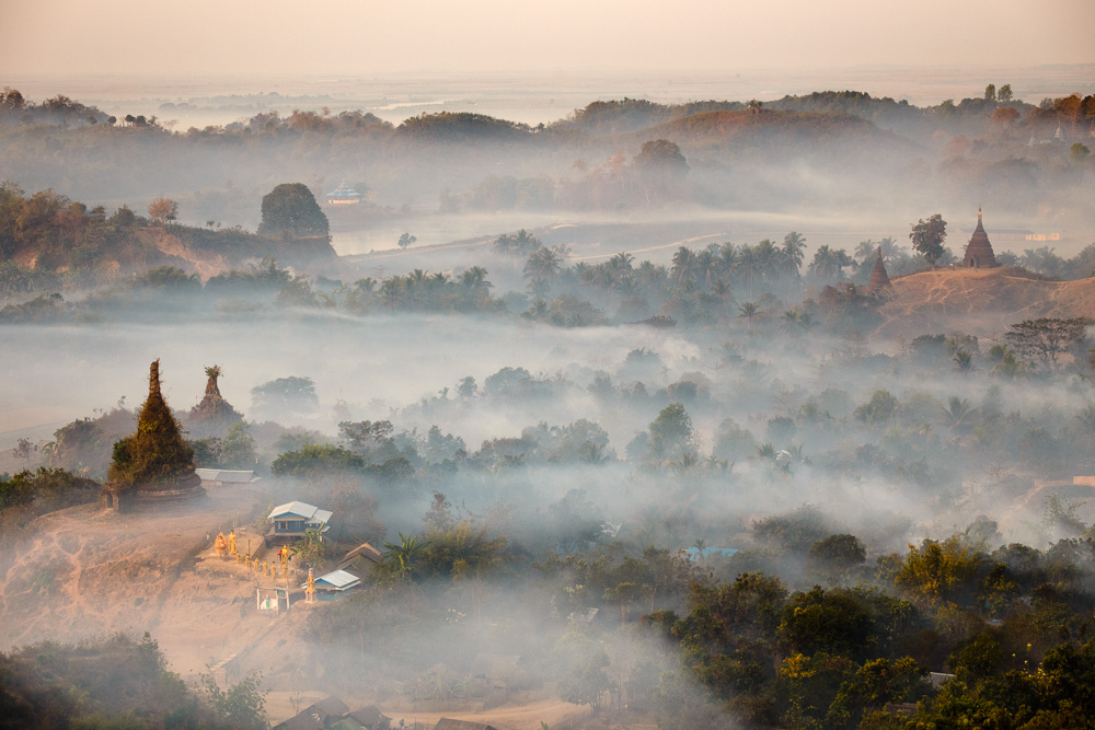 Fog and smoke shroud the temples surrounding Mrauk U, Myanmar