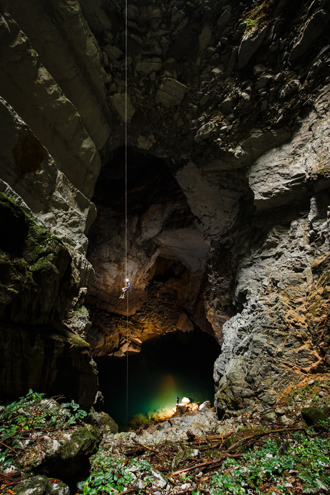 A caver descends down a shaft on expedition in Phong Nha Ke Bang, Vietnam